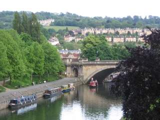 Terraced houses in Bath with canal longboats